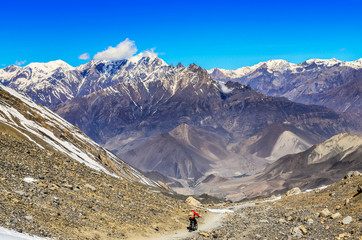 Mountain biker in Himalayas mountains
