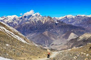 Mountain biker in Himalayas mountains