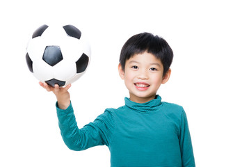 Asia little boy holding with soccer ball