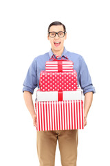 Excited young man holding presents