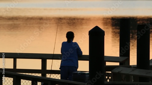 Woman on Pier at Sunset