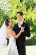 Newly wed couple dancing on wedding day