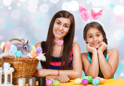 Happy girls with easter rabbit ears celebrates easter