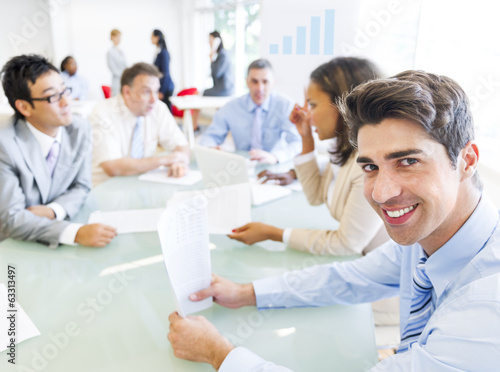 Cheerful Businessman in a Business Meeting