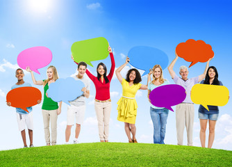 People Holding Speech Bubbles Outdoors