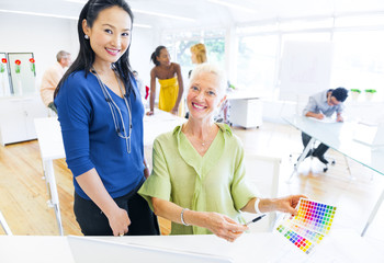 Designers Choosing Colors from the Color Swatch