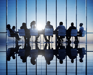 Silhouettes Of Business People In A Conference Room