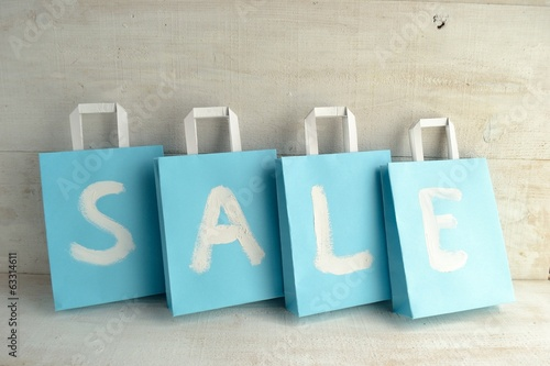 Light blue bargain sale shopping bags