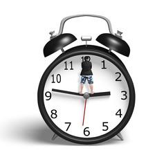 Standing on hands of alarm clock