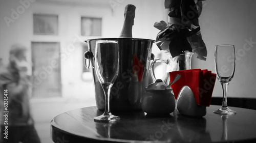 Dating black and white scene. Champagne in bucket with glasses.