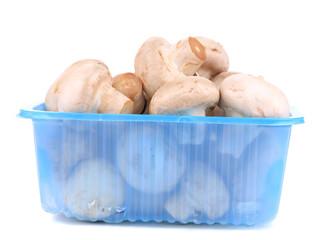 champignon mushrooms in a blue box