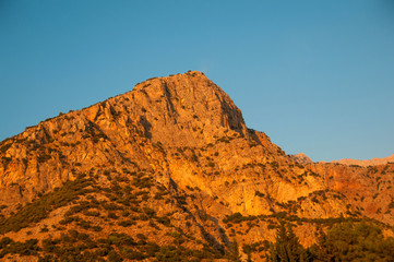 Turkey, Babadag mountain at sunset on a background of blue sky.