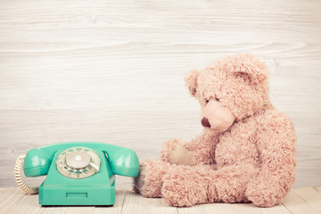 Teddy Bear near retro telephone