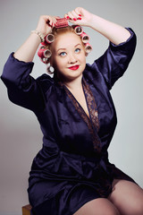 pin up girl posing with hair curlers