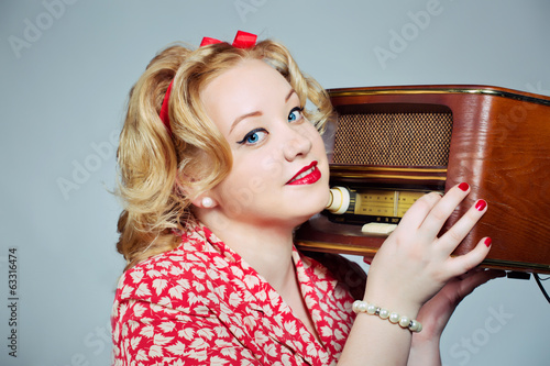 pin up girl posing with vintage radio