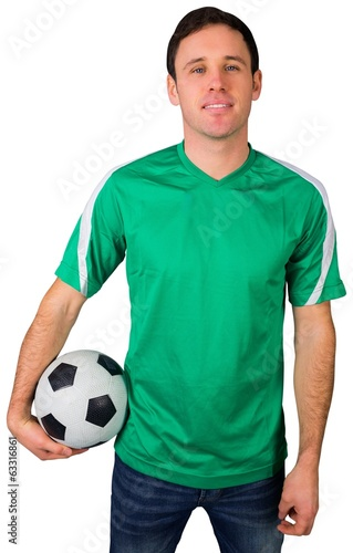canvas print picture Handsome football fan in green