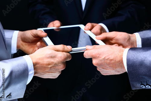 Businessmen working on a digital tablet