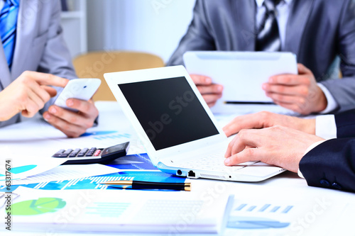Business adviser analyzing financial figures denoting