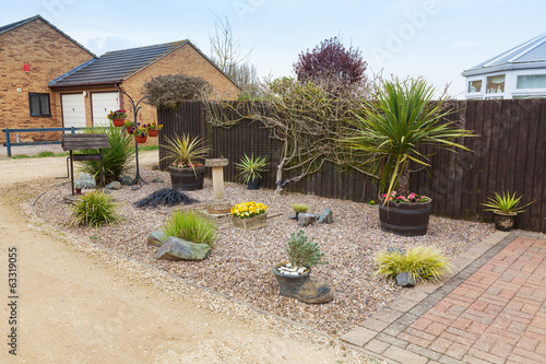 Urban rockery garden with grasses and shrubs.