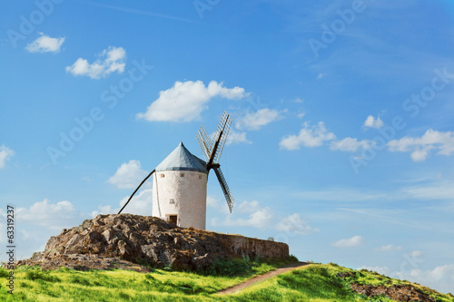 Ancient windmills in sunny summer day, Konsuegra, Spain