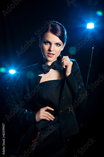 Woman in black dress and bow-tie