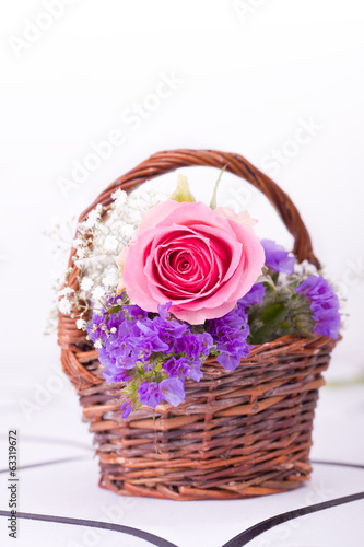 pink roses in brown basket for withe background