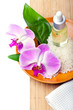 Spa setting with orchids, aromatherapy concept