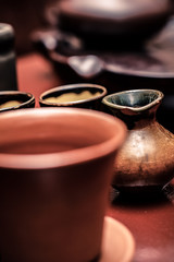 De-focused ancient tea ceremony cups