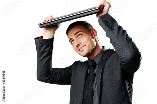 Business man hides under the laptop in his hands