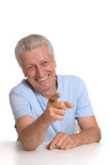 Elderly man ponting with fingers