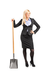 Businesswoman holding a shovel