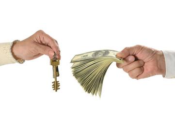 keys and dollars at miniature house