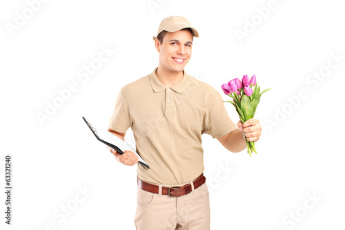 Delivery boy holding a clipboard and flowers