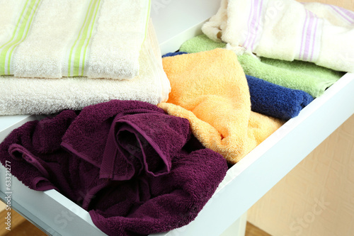 Towels in open drawer close up