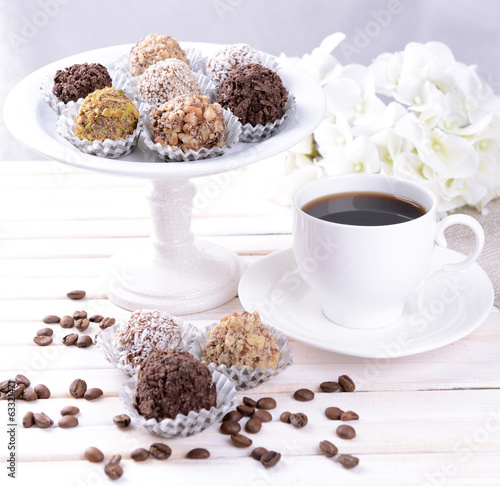 Set of chocolate candies on table on light background