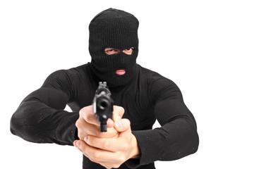 Man with a mask holding a gun