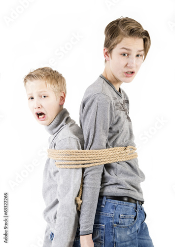 Brothers. Connected by a rope.