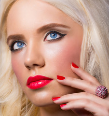 Beautiful blonde girl with perfect makeup and manicure