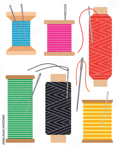 Colorful spools of sewing thread and needles
