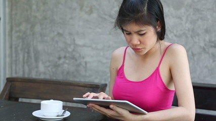 young woman using tablet searching internet for information