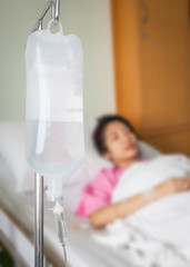 Infusion bottle with saline solution for patient in hospital roo