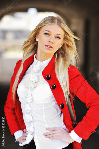 Fashion portrait of attractive young woman in red jacket
