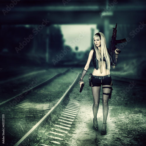 canvas print picture Sexy woman killer holding automatic and gun