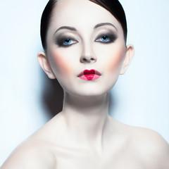 Portrait of a beautiful woman like doll with a glamorous cool ma