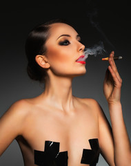 Portrait of a beautiful woman with cigar and with a glamorous re