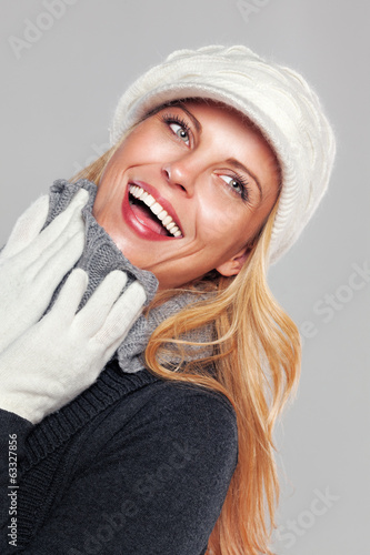 Woman smiling isolated on grey