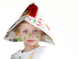 canvas print picture - Cute little boy shows his coloured hat