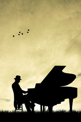 Pianist silhouette at sunset