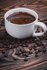 cup of hot coffee on wood background