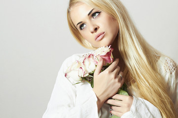 Beautiful Blond Woman with Flowers.roses.white flower